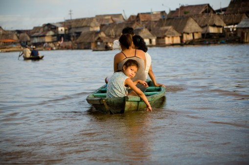 A girl crosses the Itaya River in Iquitos, Peru, by riverboat ferry.