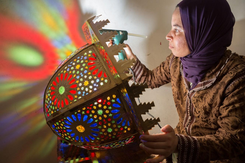 Mina Bounouader creates lighting fixtures in her workshop in Fez, Morocco.