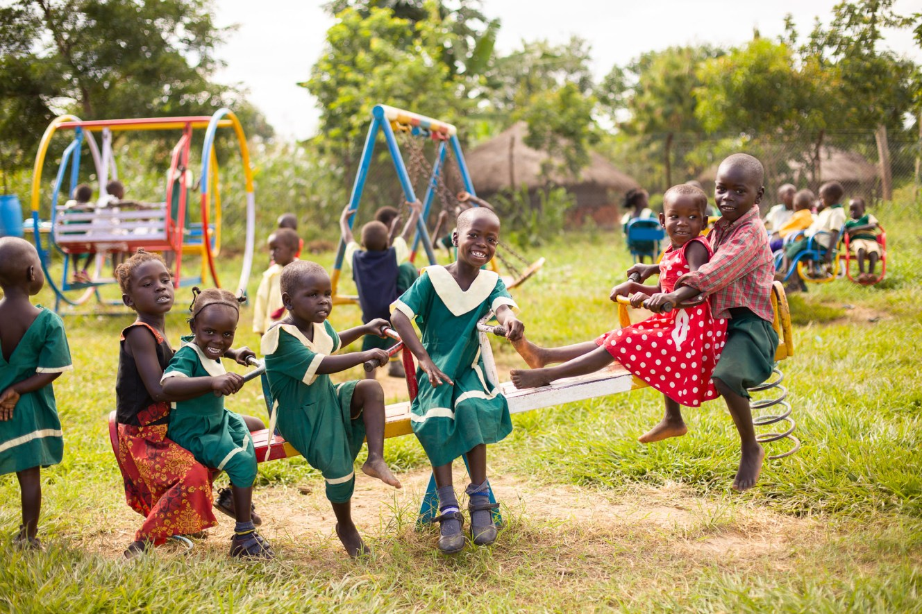 Children play together at an early childhood development center supported by ChildFund in Kiryandongo District, Uganda.