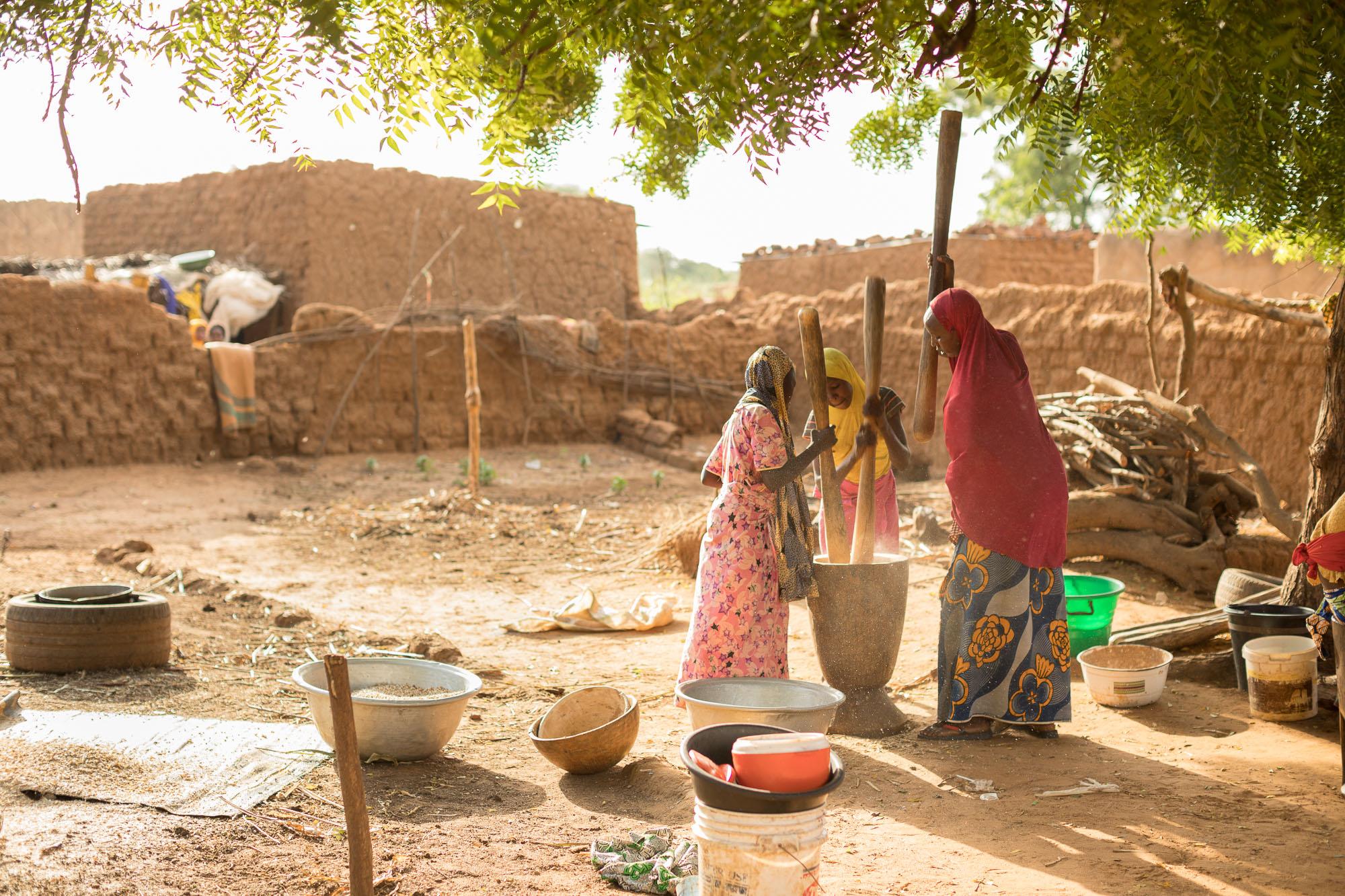 Women and girls pound cowpeas in a village in Tahoua Region, Niger.