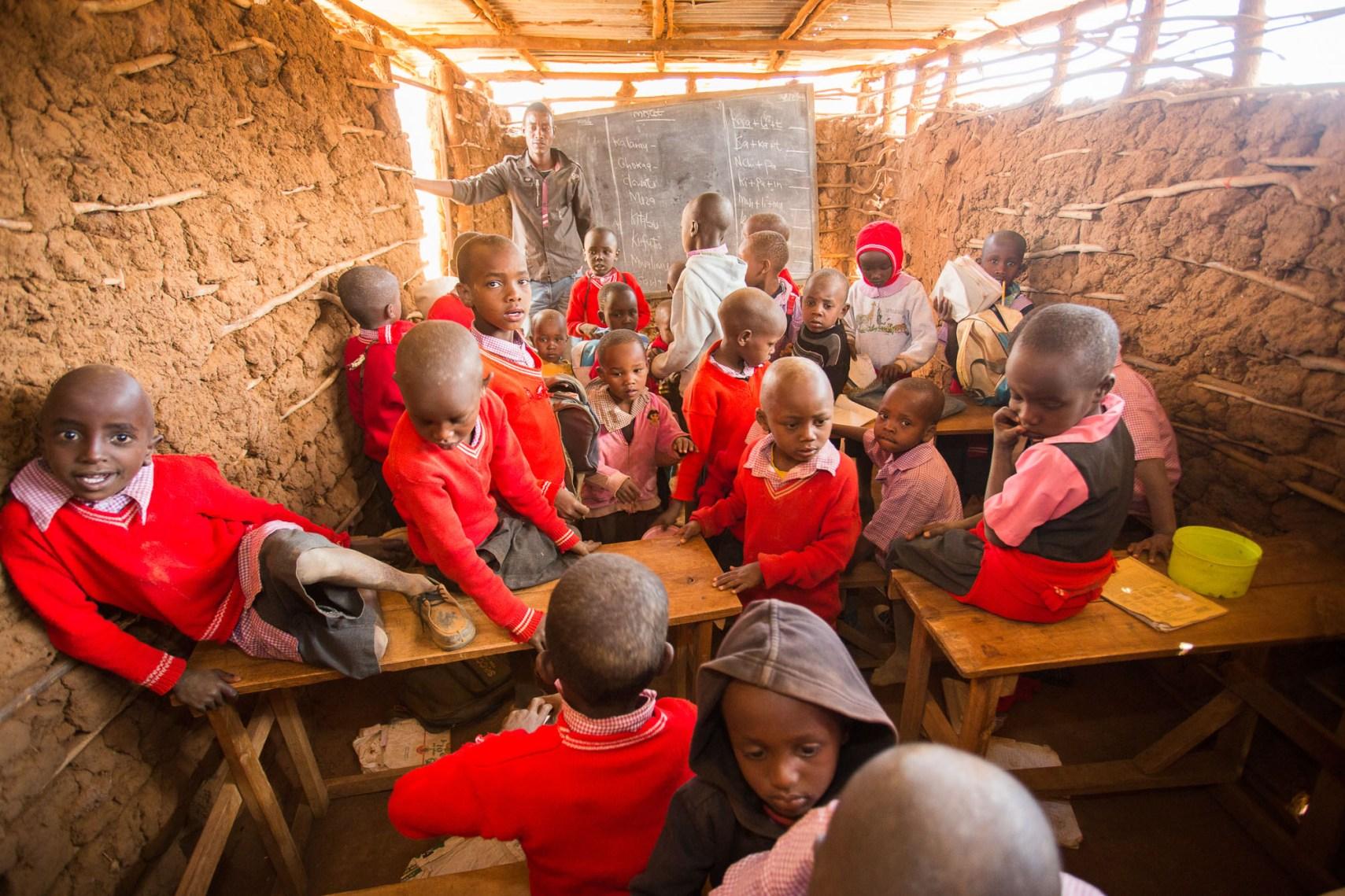 Students learn in a crowded classroom in Kajiado County, Kenya.