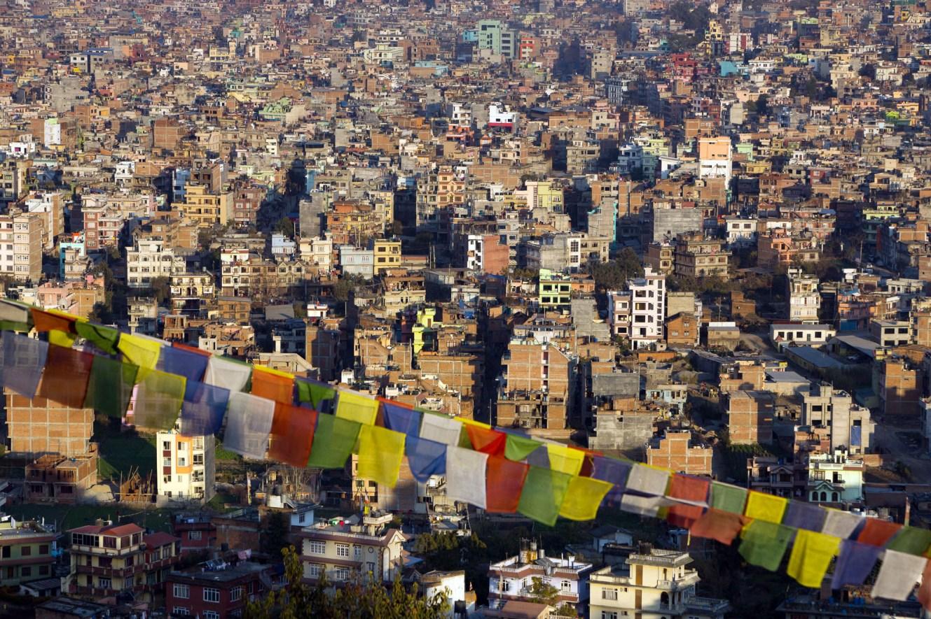 Kathmandu cityscape with Tibetan prayer flags.