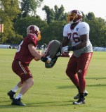 Offensive tackle Morgan Moses battles linebacker Trent Murphy during line drills. Photo by Terri Russell.