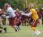 Robert Griffin III takes the snap. Photo by Jake Russell.