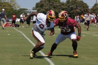 Tight end Niles Paul goes against linebacker Adam Hayward in special teams drills. Photo by Terri Russell.