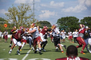 The offensive and defensive lines go at it during drills. (Photo by Jake Russell)