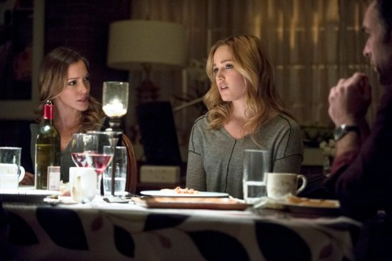 """Two years ago, the Lance Family sat at a dinner table without a care in the world. However, Laurel and Detective Lance's secrets were revealed on tonight's """"Arrow."""" (Photo property of Bonanza Productions, Berlanti Productions, DC Entertainment & Warner Bros. Television)"""