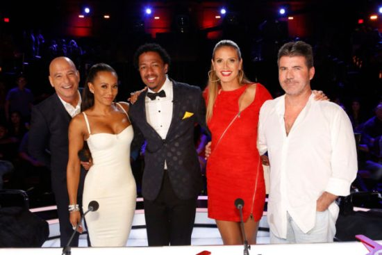 Nick Cannon and the judges pose for a photo! Which act received their last Judges' Save of the season? (Photo property of NBC's Trae Patton)
