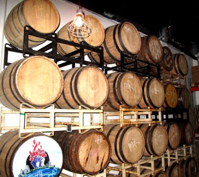 The wall of barrels filled with various spirits and cordials.