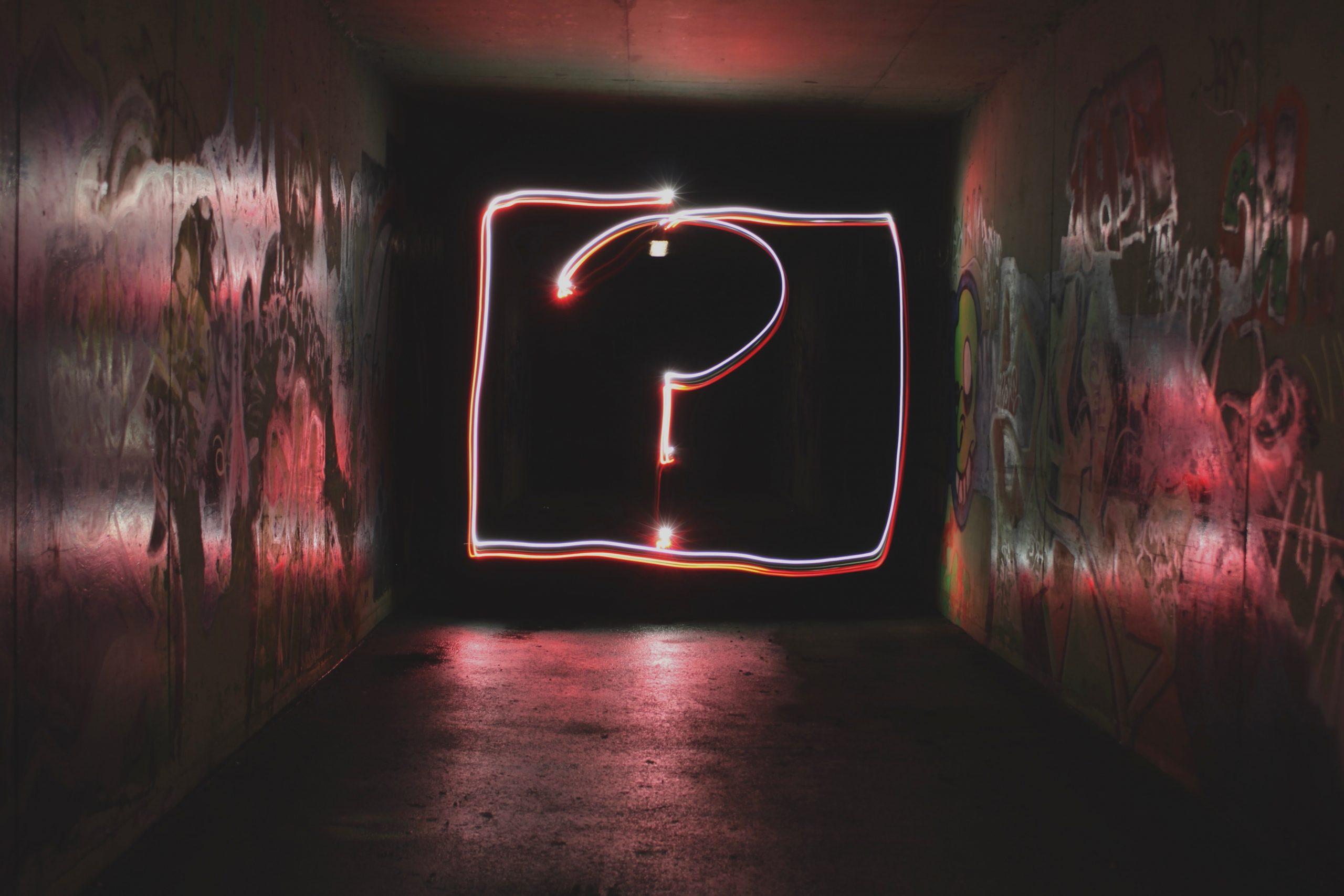 Question Mark Neon Sign at end of Tunnel