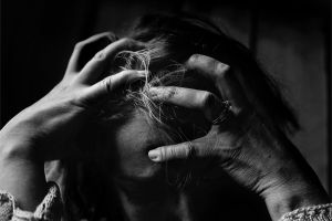 To fail is distressing - Woman distressed from failure (black and white)