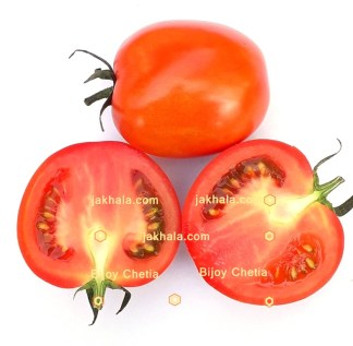 One complete tomato with two halves of tomato