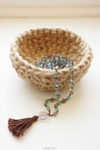 jute crochet bowl with a mala necklace