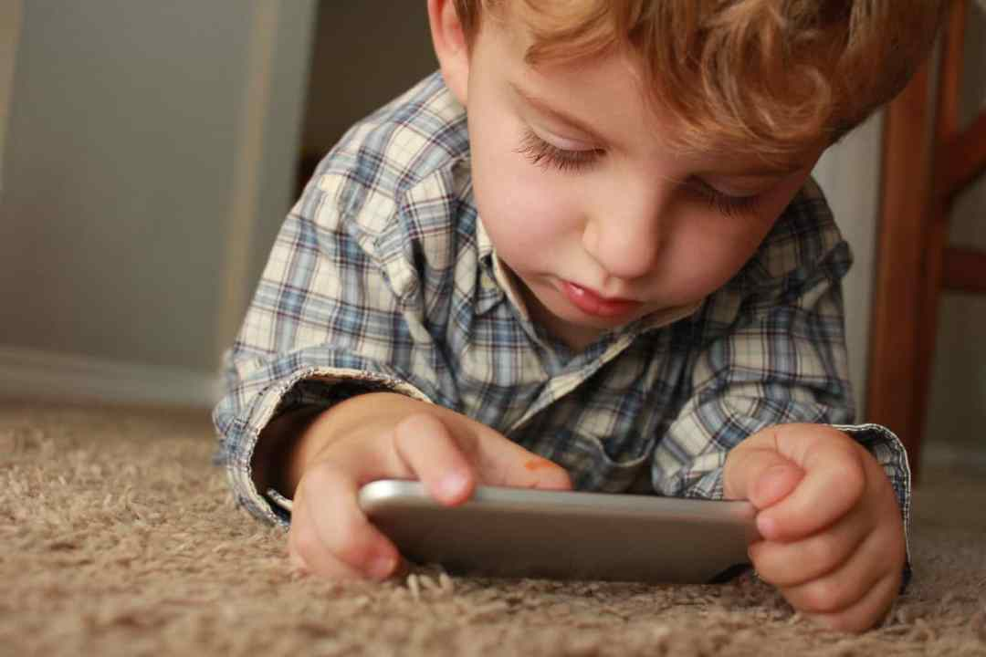 Child playing with an iPhone