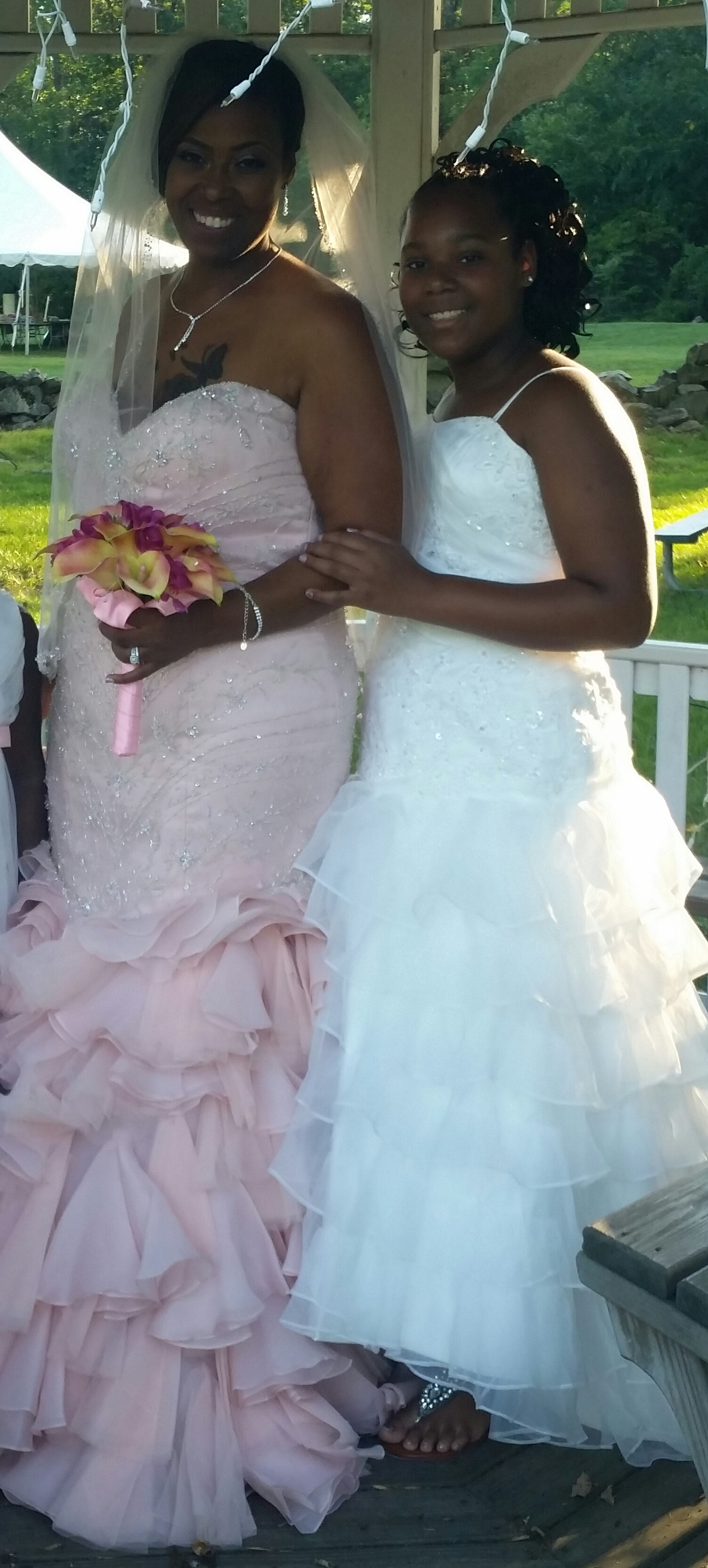 Mother daughter bridal gowns. Tulle mermaid dresses with tiered skirt.