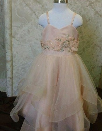Sherbet flower girl dress was designed to Match our brides Lazaro 3250 wedding dress