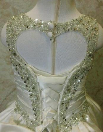 Jewel encrusted flower girl dress with heart cutout in back