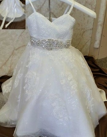 Wedding dress for baby girls, with a tiny train. Baby flower girl dress with sparkling sequins and crystal beaded sash.