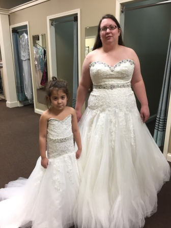 Matching bride and flower girl dresses.