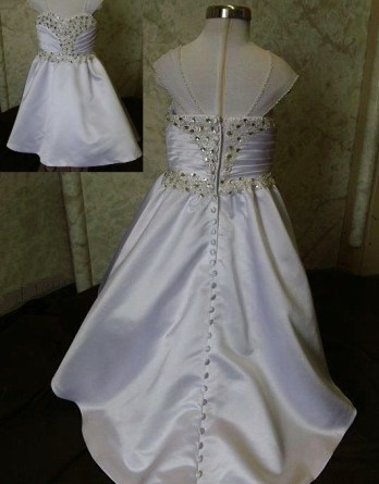 Sweetheart miniature crystal wedding dress has ruched crystal bodice. Covered buttons run down the length of the train.