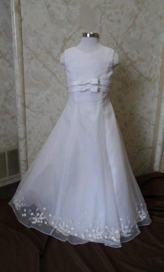 Long white sleeveless bargain flower girl dresses. Empire waist bows, and embroidered hem line. On sale for $40.