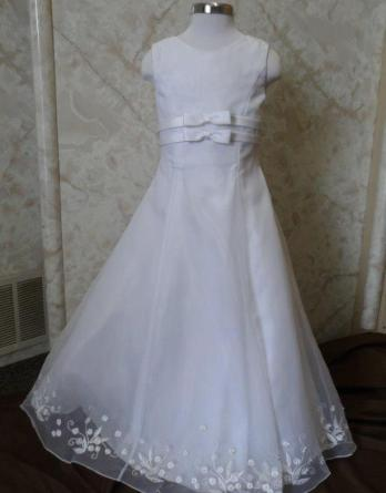 Long white sleeveless bargain flower girl dresses. Empire waist bows, and embroidered hem line. On sale for $40.