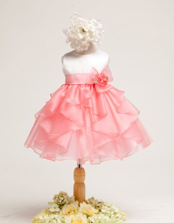 Lovely coral baby dress. Sleeveless satin bodice with organza ruffle skirt. Flower decoration on the side of waistband.