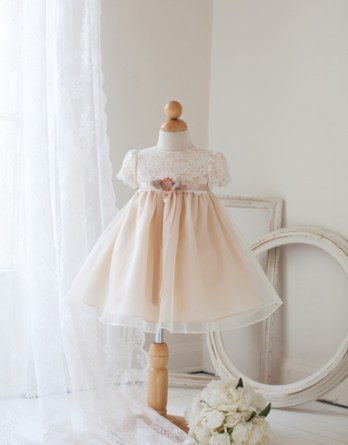 Infant girls dresses in ivory/tan. This adorable dresses has a lace covered bodice and short sleeves. Sale price $40.00.