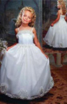 Long white or ivory flower girl dresses. Spaghetti strap dress with a ruffles.
