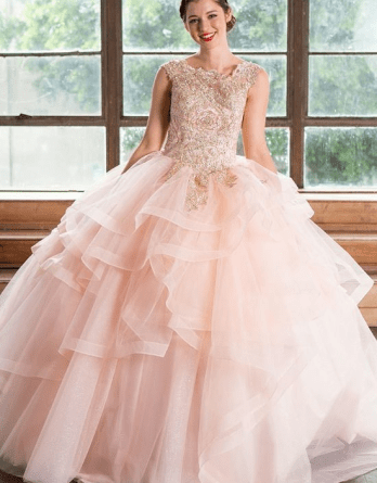 Open back prom gown has layered full ball gown skirt. Pageant cap sleeve ball gown with horsehair trim sweep train.