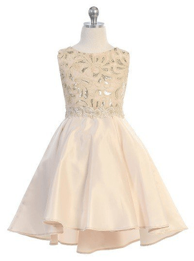 Girls formal champagne dresses. Sleeveless dress with round neck, shiny pattern bodice, high low skirt with pleated back.