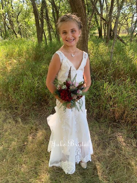 flower girl dress matches the brides dress