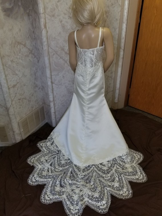 Plunging lace miniature bride dress, with scalloped lace train.