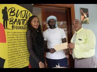 From left: Rosemary Duncan, director, Buju Banton Foundation; reggae and dancehall icon Buju Banton and Patrick Newman, director, Mount Olivet Boys' Home.