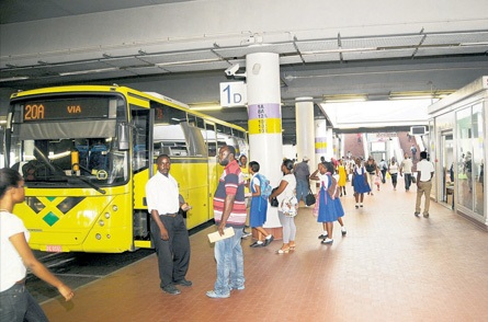 Commuters waiting for their buses at a terminal in the Half Way Tree Transport Centre (Source: Jamaica Observer)