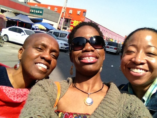 (l-r) Dawn, Latoya and me after strolling through a market that sells food, live fish and exotic seafood, clothes hardware, and anything you can think of, on Wednesday, May 1, 2013. (Photo credit: Latoya McFarlane)