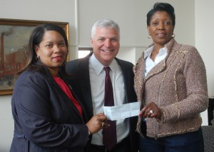 Suffolk County District Attorney Dan Conley (center) delivers a $5,000 check to Rev. Kim Odom (left) and Ruth Rollins (right), field directors of JP's Operation LIPSTICK, last month. (Courtesy Photo)