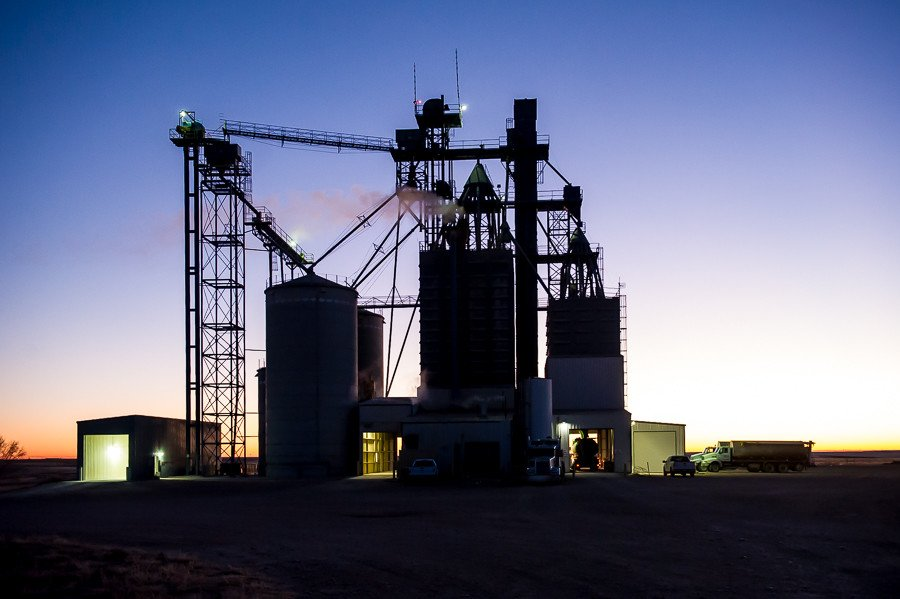 A feed mill/grain elevator in the Oklahoma panhandle dispenses feed into trucks for the cattle and swine feedlots in the area.