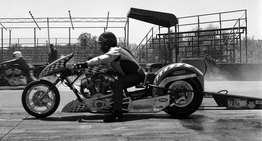 "A nitro-methane burning Harley Davidson based motorcycle drag racer at the PMRA motorcycle drag races in Tulsa.  Shot on Kodak Plus-X PAN film on a Toyo VRX-125 4""x5"" film camera."