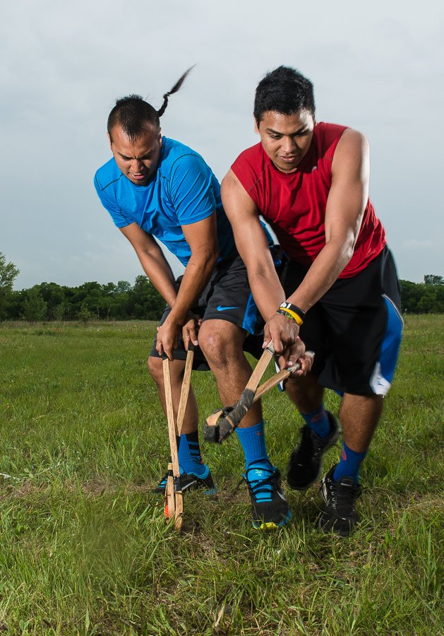 Billy Eagleroad (blue) blocks his brother Jordon Eagleroad during Choctaw Indian stickball practice.