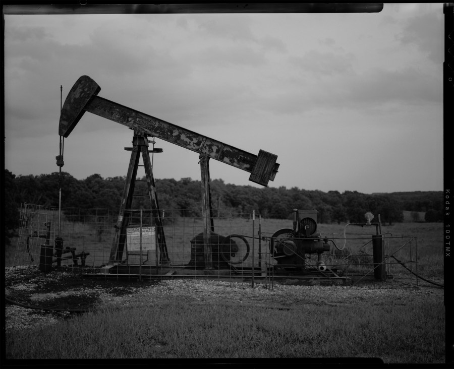 Oil field pump jack south of Barnsdall, Oklahoma shot on black and white Kodak TMAX-100 film with Toyo 45a view camera.