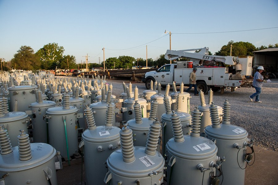 Electrical transformers of various sizes are stored at the Northfork Electric Coop yard.