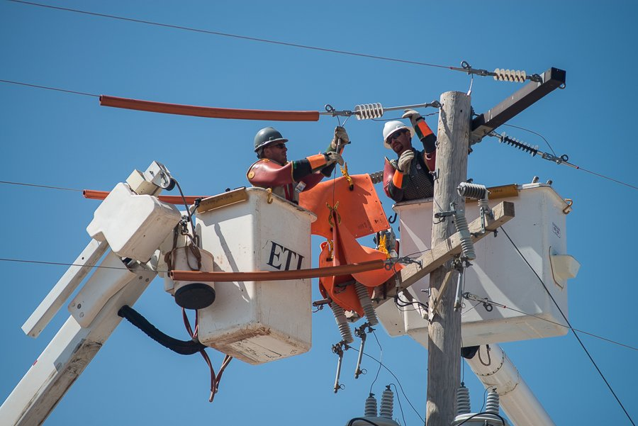 Electrical linemen regularly work on live electricity and must take numerous precautions so they don't get injured from high voltage electrical lines.