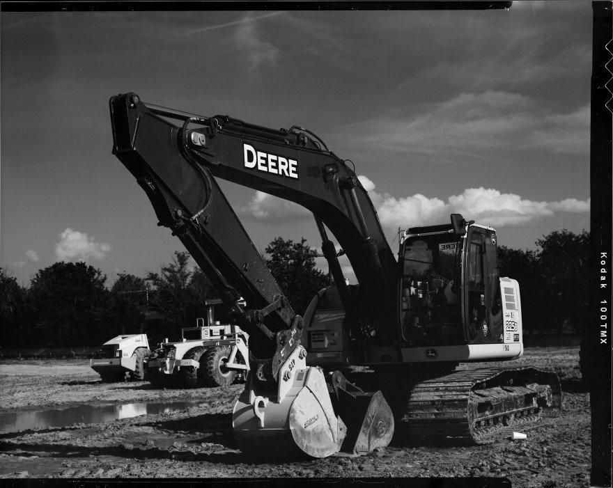 John Deere trackhoe at an Edmond construction site.