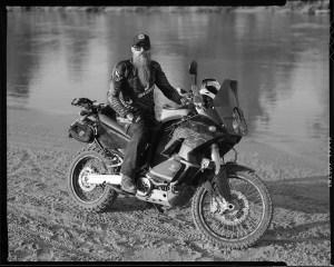 Tobin Vigil, owner of Buchanan Bicycles in Norman, on his KTM 950 Adventure motorcycle.