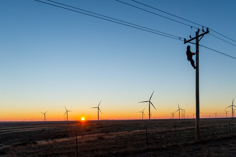 An electrical ineman climbs poles in the Oklahoma panhandle for Tri-County Electric Coop TCEC utility lines for Tri-County Electric Coop TCEC