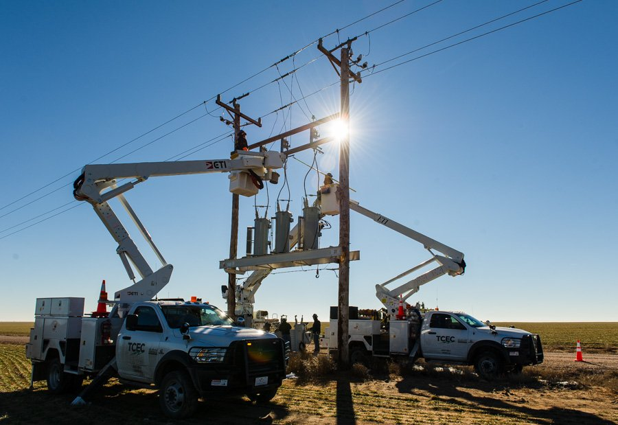 Lineman work to install electrical equipment for Tri-County Electric Coop TCEC