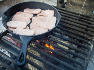 We cook a breakfast of Spam over the campfire at the start of our third day of pheasant hunting in South Dakota.