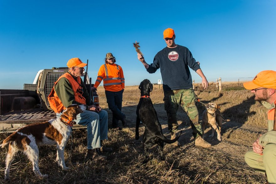 "As we waited to hunt one of our ""honey holes"" on the last day in South Dakota, a couple of local hunters joined us with their dog."