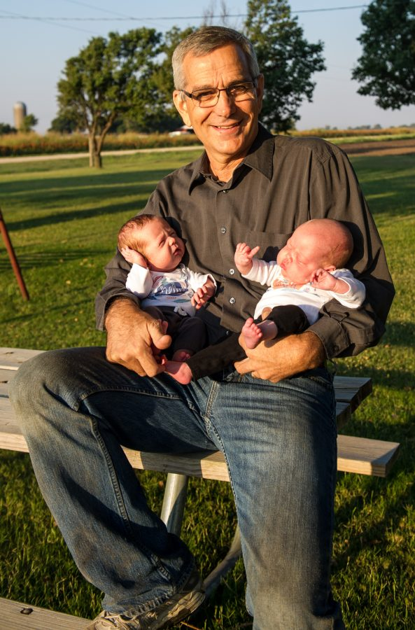 Oklahoma Secretary of Agriculture Jim Reese holds his grandkids on his farm north of Nardin, OK.